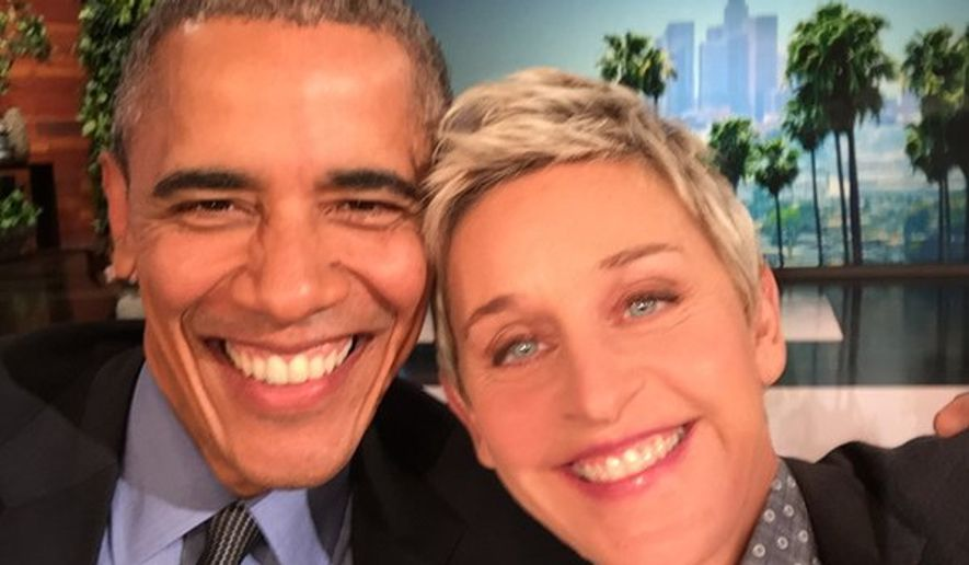 President Obama takes a selfie with talk show host Ellen DeGeneres.