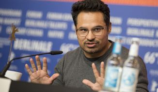 Actor Michael Pena speaks during a press conference for the film 'War On Everyone' at the 2016 Berlinale Film Festival in Berlin, Germany, Friday, Feb. 12, 2016. (AP Photo/Axel Schmidt)