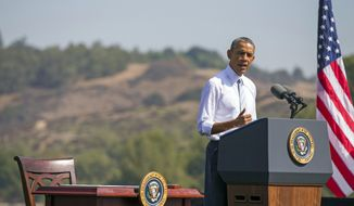 In this Oct. 10, 2014, file photo, President Barack Obama speaks at Frank G. Bonelli Regional Park in San Dimas, Calif., as he designated the nearly 350,000 acres within the San Gabriel Mountains northeast of Los Angeles a national monument. Obama, in California this week for a fund-raising swing, plan to make the announcement Friday, Feb. 12, 2016. In all, Obama will name three specific regions national monuments –Mojave Trails, Castle Mountains (both in the Mojave Desert) and Sand to Snow in the Sonoran Desert. (AP Photo/Evan Vucci, File)