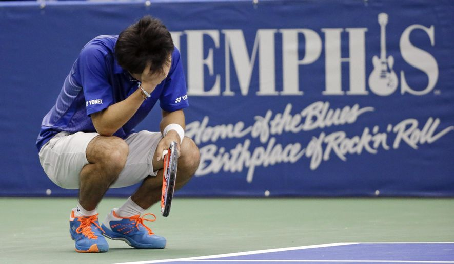 Yoshihito Nishioka, of Japan, reacts after losing a point to Sam Querrey in a quarterfinal at the Memphis Open tennis tournament Friday, Feb. 12, 2016, in Memphis, Tenn. Querrey won the match 6-3, 6-4. (AP Photo/Mark Humphrey)