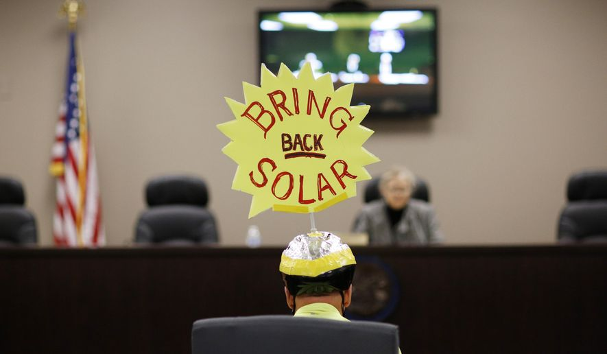 A man speaks at the Public Utilities Commission of Nevada, Friday, Feb. 12, 2016, in Las Vegas. Regulators with the commission are expected to vote Friday on a measure to ease existing solar customers into higher rates at a slower pace than previously approved, although the decision is so fraught that solar proponents have promised a referendum and are demanding a special legislative session. (AP Photo/John Locher)
