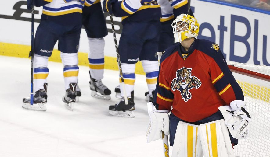 Florida Panthers goalie Roberto Luongo, foreground, reacts as St. Louis Blues players celebrate after center Robby Fabbri scored during the first period of an NHL hockey game, Friday, Feb. 12, 2016, in Sunrise, Fla. (AP Photo/Wilfredo Lee)