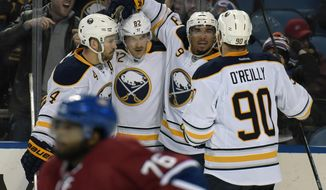 Buffalo Sabres' Josh Gorges (4), Marcus Foligno (82), Evander Kane (9) and Ryan O'Reilly (90) celebrate a goal by Kane as Montreal Canadiens' P.K. Subban (76) reacts during the first period of an NHL hockey game, Friday, Feb. 12, 2016, in Buffalo, N.Y. (AP Photo/Gary Wiepert)
