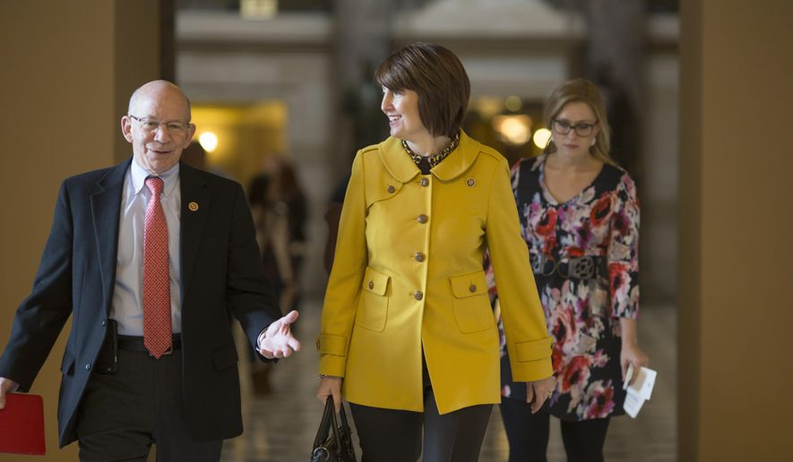 Rep. Cathy McMorris Rodgers, R-Wash., center, walks to the House chamber on Capitol Hill in Washington, Friday, Feb. 12, 2016, with Rep. Peter DeFazio, R-Ore., left, as the House votes to approve her bill to give supermarkets, fast-food chains and other businesses some relief from calorie labeling rules that go into effect at the end of the year.   (AP Photo/J. Scott Applewhite)