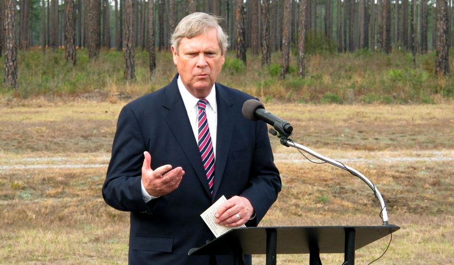 Agriculture Secretary Tom Vilsack speaks Friday, Feb. 12, 2016, during an event at Fort Stewart, GA., announcing $720 million in conservation funding being awarded to 84 projects across the U.S. Fort Stewart, the largest Army post east of the Mississippi River, is receiving $2 million to assist its efforts to preserve more than 278,000 acres of longleaf pine forest that is home to endangered red-cockaded woodpeckers. (AP Photo/Russ Bynum)