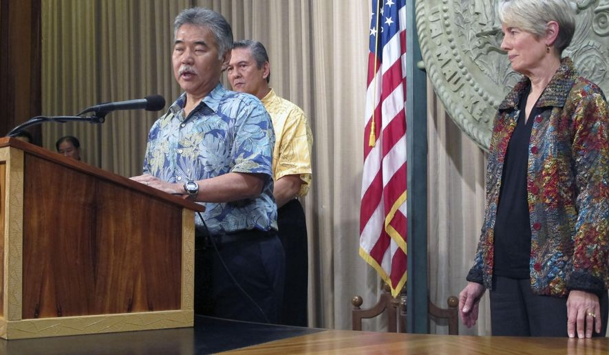 Hawaii Gov. David Ige, left, talks to reporters about the state's plans for fighting mosquito-borne illness as George Szigeti, president and CEO of the Hawaii Tourism Authority, center, and Virginia Pressler, director of the state Department of Health, listen on Friday, Feb. 12, 2016 in Honolulu. Ige declared a state of emergency to fight mosquito borne illnesses including dengue fever and the Zika virus. (AP Photo/Cathy Bussewitz)
