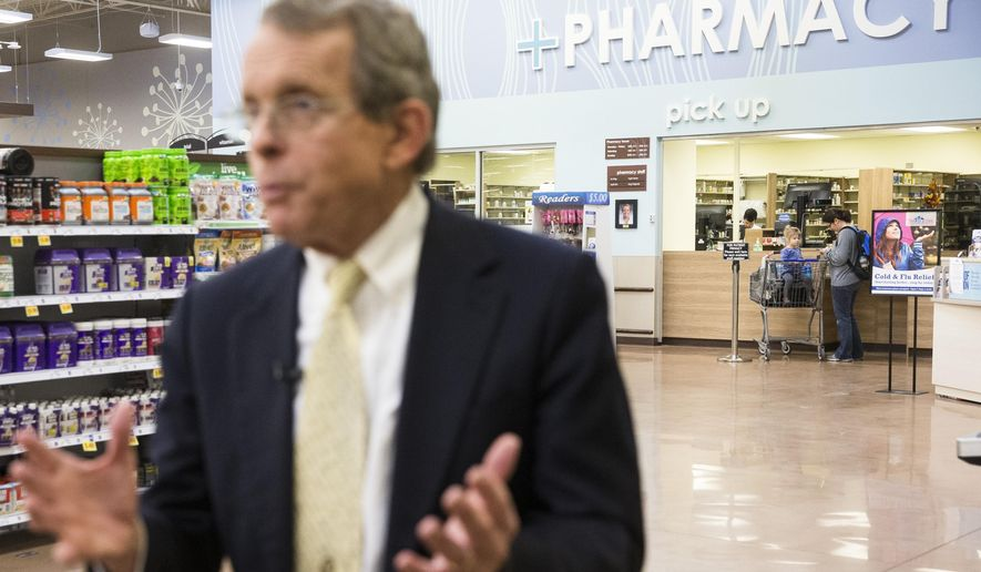 Ohio Attorney General Mike DeWine is interviewed as customers visit the pharmacy during a news conference at the Oakley Kroger Marketplace store to announce the supermarket chain's decision to offer the opioid overdose reversal medicine Naloxone without a prescription, Friday, Feb. 12, 2016, in Cincinnati. Naloxone is routinely carried by fire-rescue crews, which use it thousands of times a year in Ohio to revive overdose victims. Kroger, based in Cincinnati, has 2,774 supermarkets and multi-department stores in 35 states and the District of Columbia. (AP Photo/John Minchillo)