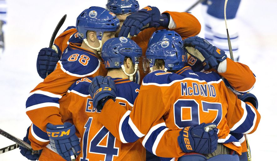 Edmonton Oilers celebrate a goal against the Toronto Maple Leafs during the second period of an NHL hockey game, Thursday, Feb. 11 2016, in Edmonton, Alberta.  (Jason Franson/The Canadian Press via AP) MANDATORY CREDIT