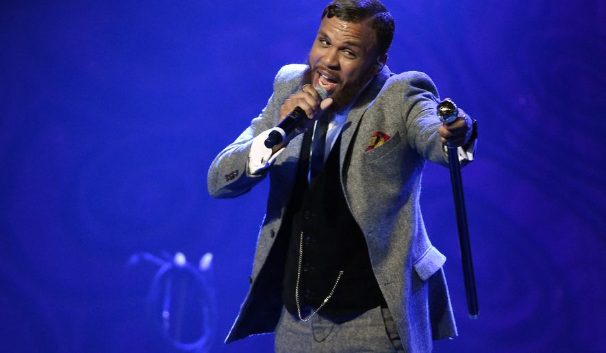 """FILE - In this Dec. 2, 2015 file photo, Jidenna performs during EBONY magazine's 30th Annual Power 100 Gala in Beverly Hills, Calif. Jidenna, who is putting the final touches on his debut album, is nominated for a Grammy for best rap/sung collaboration for his """"Classic Man"""" single, which features Roman GianArthur. (Photo by Chris Pizzello/Invision/AP, File)"""