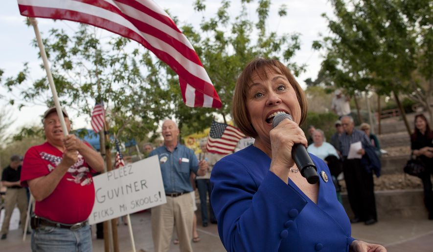 File - In this April 15, 2011 file photo, Sharron Angle, right, sings during a rally by Tea Party supporters in Las Vegas. Nevada conservative Angle says she's trying to determine if she could raise enough money to run for the U.S. Senate again, a move that could throw a wrench in Republicans' hopes to claim Democratic Sen. Harry Reid's soon-to-be-vacant seat. (AP Photo/Julie Jacobson, file)