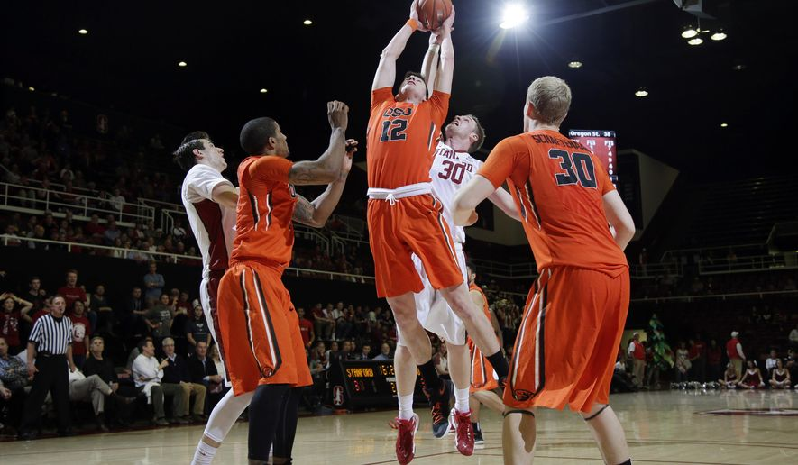 Oregon State forward Drew Eubanks (12) grabs a rebound in front of Stanford center Grant Verhoeven (30) during the second half of an NCAA college basketball game Thursday, Feb. 11, 2016, in Stanford, Calif. Oregon State won 62-50. (AP Photo/Marcio Jose Sanchez)