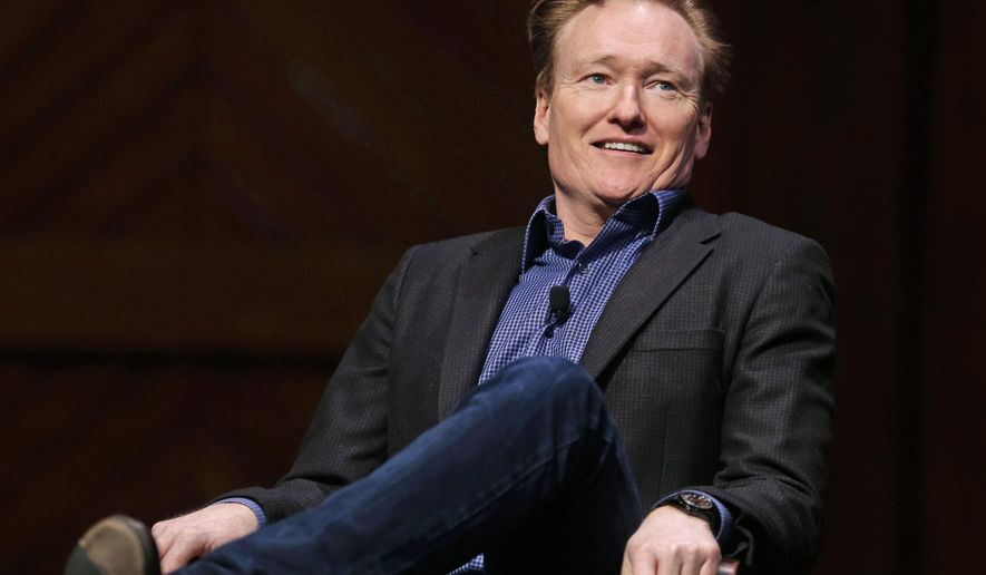 Television host Conan O'Brien smiles towards the audience at Sanders Theatre on the campus of Harvard University in Cambridge, Friday, Feb. 12, 2016.  O'Brien, who graduated from the school in 1985, shared a conversation with Harvard President Drew Faust and an audience of guests. (AP Photo/Charles Krupa)