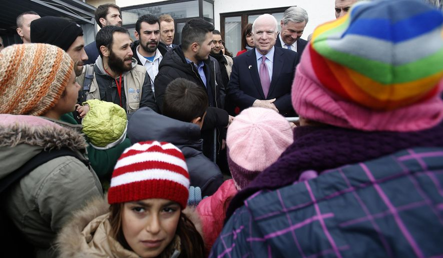 U.S. Sen. John McCain visits a refugee center at the train station in Sid, about 100 km west from Belgrade, Serbia, Friday, Feb. 12, 2016. Sen. McCain and a U.S. Congress delegation pledged assistance to Serbia and other countries along the Balkan migrant route. (AP Photo/Darko Vojinovic)