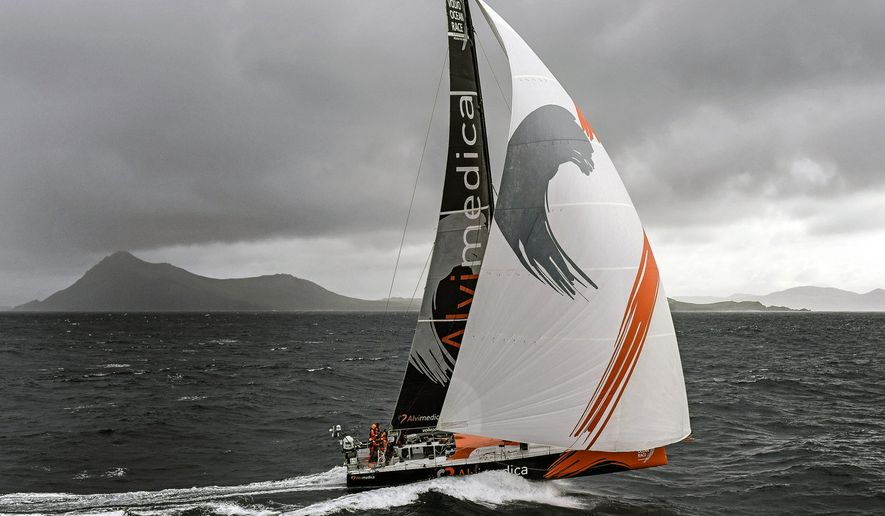 This March 30, 2013, photo provided by Mark Towill shows team Alvimedica rounding Cape Horn in the lead in the fifth leg of the Volvo Ocean Race. With the wind, and their competitors at their backs, Charlie Enright and Mark Towill rounded Cape Horn and took a few seconds to savor the accomplishment. Considered to be the nautical equivalent of summiting Mount Everest, the rounding came in daylight, going 30 knots downwind on the fifth leg of the Volvo Ocean Race. (Rick Tomlinson/Volvo Ocean Race via AP)