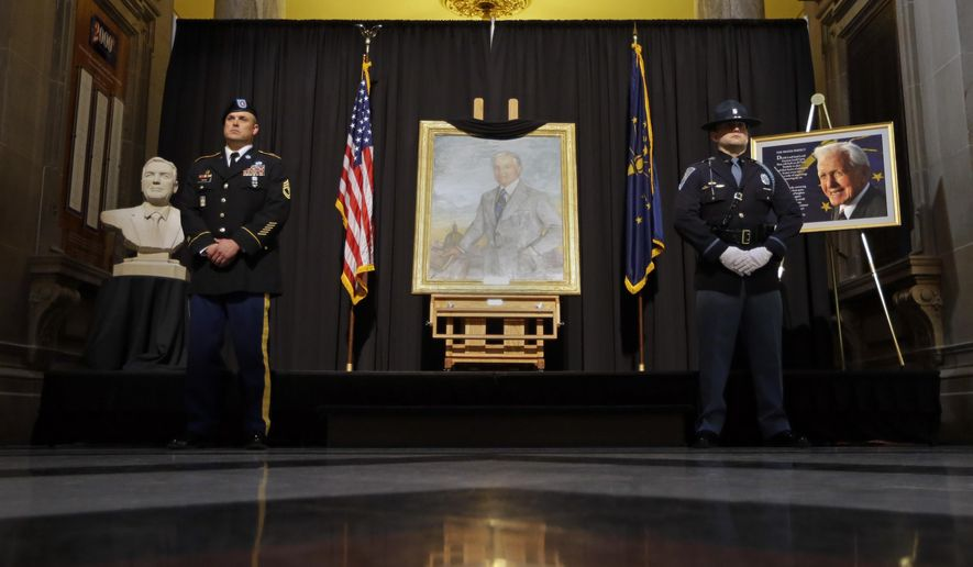 An honor guard from members of the Indiana State Police and the Indiana National Guard hold standing honors for former Indiana Gov. Edgar Whitcomb at a memorial at the Statehouse in Indianapolis, Thursday, Feb. 11, 2016. Whitcomb, a Republican, was governor from 1969 to 1973 and died last Thursday, Feb. 4, at the age of 98. The funeral will be held at the Statehouse on Friday. (AP Photo/Michael Conroy)