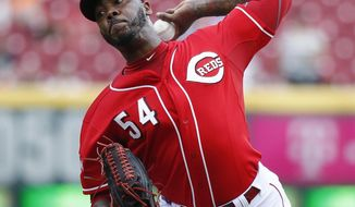 FILE - In this Sept. 7, 2015, file photo, Cincinnati Reds relief pitcher Aroldis Chapman throws in the ninth inning of a baseball game against the Pittsburgh Pirates in Cincinnati. Chapman and the New York Yankees have agreed to a one-year contract worth $11,325,000, avoiding salary arbitration. (AP Photo/John Minchillo, File)