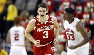 Wisconsin guard Zak Showalter (3) reacts after hitting a 3-pointer during the second half of the team's NCAA college basketball game against Maryland, Saturday, Feb. 13, 2016, in College Park, Md. Wisconsin won 70-57. (AP Photo/Patrick Semansky)
