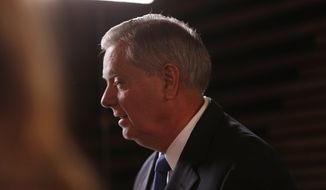 U.S. Sen Lindsey Graham, R-S.C., speaks to the media before the CBS News Republican presidential debate at the Peace Center, Saturday, Feb. 13, 2016, in Greenville, S.C. Graham spoke about the death of Supreme Court Justice Antonin Scalia who died today at 79.  (AP Photo/John Bazemore)