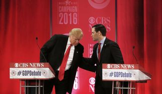 Republican presidential candidate, Sen. Marco Rubio, R-Fla., right, speaks with Republican presidential candidate, businessman Donald Trump  during the CBS News Republican presidential debate at the Peace Center, Saturday, Feb. 13, 2016, in Greenville, S.C. (AP Photo/John Bazemore)