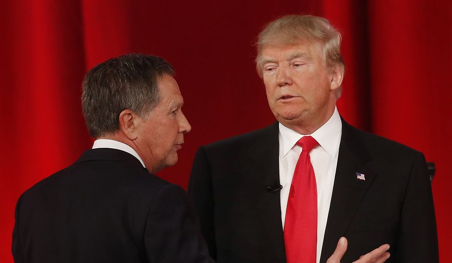 Ohio Gov. John Kasich (left) speaks to businessman Donald Trump  during a commercial break during the CBS News Republican presidential debate at the Peace Center in Greenville, S.C., on Feb. 13, 2016. (Associated Press) **FILE**