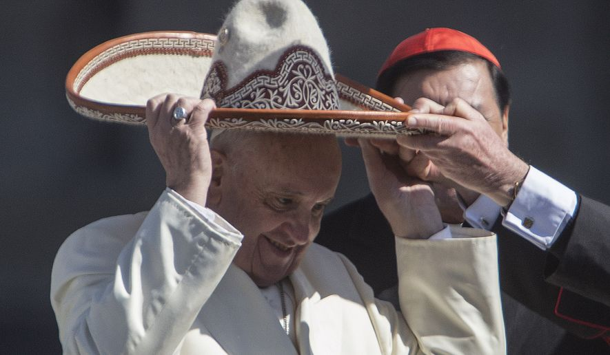 Pope Francis dons a Mexican charro style sombrero, in Mexico City's main sqaure, the Zocalo, Saturday, Feb. 13, 2016. Pope Francis kicks off his first trip to Mexico on Saturday with speeches to the country's political and ecclesial elites. The pontiff's five-day visit will include a very personal prayer at the Virgin of Guadalupe shrine. (AP Photo/Christian Palma)