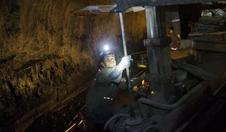 """FILE - In this Oct. 6, 2015 photo, a miner works underground in the Sewell """"R"""" coal mine in Yukon, W.Va. For the long-suffering communities that depend on coal, a recent Supreme Court ruling temporarily blocking greenhouse gas reductions was seen as a rare victory. But coal country residents say the reprieve may only be temporary as utilities turn away from coal generation and production continues to slide. (AP Photo/David Goldman, File)"""