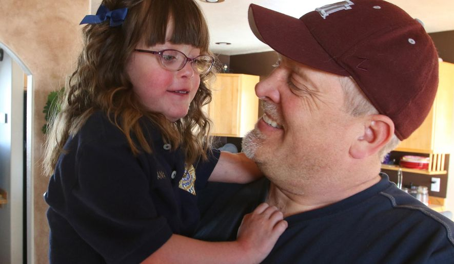 Wayne Halvorsen, right, laughs with his 6-year-old daughter Annalyn at their home in Butte, Mont., on Feb. 5, 2016. Annalyn was born six weeks early and within a day was diagnosed with hypoplastic left heart syndrome, a rare heart defect that causes the heart to be severely under-developed. (Walter Hinick/The Montana Standard via AP) MANDATORY CREDIT