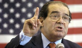 In this Wednesday, April 7, 2004, file photo, U.S. Supreme Court Justice Antonin Scalia speaks to Presbyterian Christian High School students in Hattiesburg, Miss. On Saturday, Feb. 13, 2016, the U.S. Marshals Service confirmed that Scalia has died at the age of 79. (Gavin Averill/The Hattiesburg American via AP)