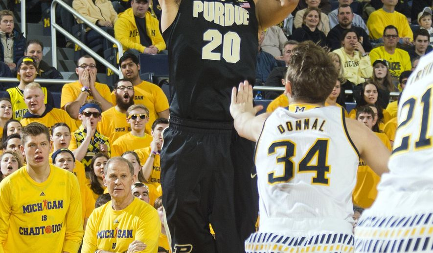 Purdue center A.J. Hammons (20) shoots over Michigan forward Mark Donnal (34) in the first half of an NCAA college basketball game in Ann Arbor, Mich., Saturday, Feb. 13, 2016. (AP Photo/Tony Ding)
