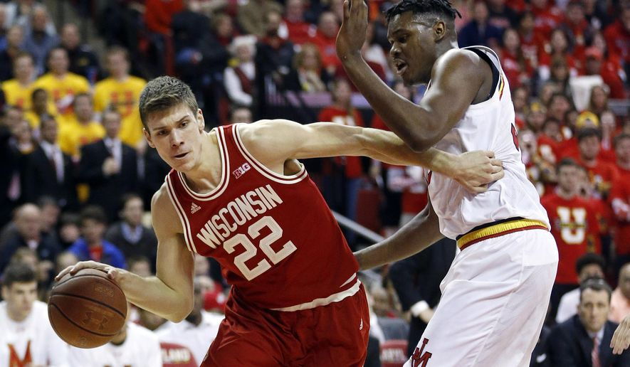 Wisconsin forward Ethan Happ, left, drives to the basket around Maryland center Diamond Stone during the first half of an NCAA college basketball game Saturday, Feb. 13, 2016, in College Park, Md. (AP Photo/Patrick Semansky)