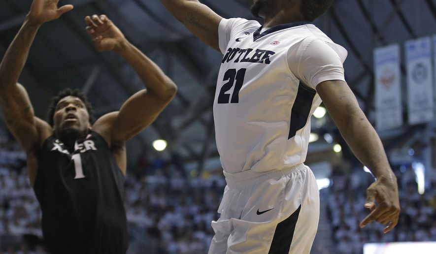 Butler's Roosevelt Jones (21) puts up a shot against Xavier's Jalen Reynolds (1) during the first half of an NCAA college basketball game Saturday, Feb. 13, 2016, in Indianapolis. (AP Photo/Darron Cummings)