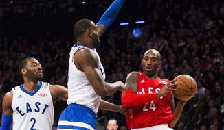 Western Conference's Kobe Bryant, of the Los Angeles Lakers, (24) drives to the net against Eastern Conference's LeBron James, of the Cleveland Cavaliers, (23) and Washington Wizards' John Wall (2) during second half NBA All-Star Game basketball action in Toronto on Sunday, Feb. 14, 2016. (Mark Blinch/The Canadian Press via AP) MANDATORY CREDIT