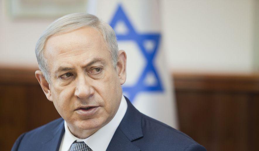 Israeli Prime Minister Benjamin Netanyahu speaks during the weekly cabinet meeting in Jerusalem. Sunday, Feb. 14, 2016. (AP Photo/Dan Balilty, Pool)