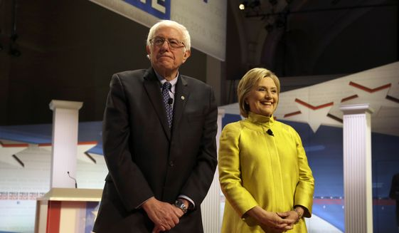 Democratic presidential candidates Sen. Bernard Sanders, I-Vt., left, and former Secretary of State Hillary Clinton take the stage before a Democratic presidential primary debate at the University of Wisconsin-Milwaukee, Thursday, Feb. 11, 2016, in Milwaukee. (AP Photo/Tom Lynn)'