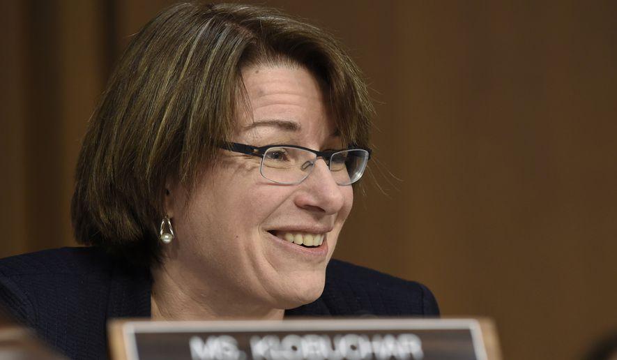 In this Jan. 28, 2015 file photo, Sen. Amy Klobuchar, D-Minn. is seen on Capitol Hill in Washington. (AP Photo/Susan Walsh)