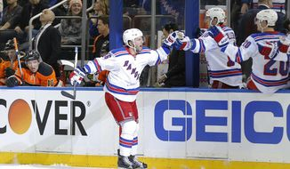 New York Rangers center Derick Brassard (16) celebrates his first period goal against the Philadelphia Flyers during an NHL hockey game, Sunday, Feb. 14, 2016, in New York. (AP Photo/Julie Jacobson)