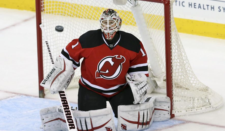 New Jersey Devils goalie Keith Kinkaid (1) watches a shot on goal during the second period of an NHL hockey game against the Los Angeles Kings, Sunday, Feb. 14, 2016, in Newark N.J. (AP Photo/Mel Evans)