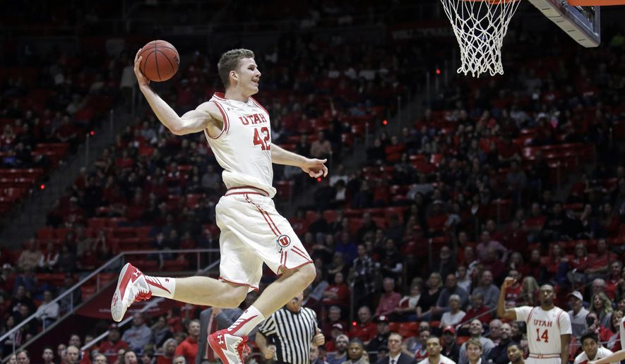 Utah forward Jakob Poeltl (42) goes to the basket for a dunk during the second half in an NCAA college basketball game against Washington State Sunday, Feb. 14, 2016, in Salt Lake City. (AP Photo/Rick Bowmer)