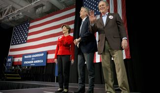 President George W. Bush and former first lady Laura Bush were at the side of Republican presidential candidate Jeb Bush as he stumped Monday in South Carolina, just days before the state's primary. (Associated press)
