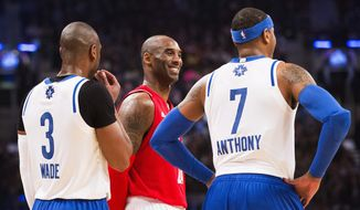 Western Conference's Kobe Bryant, of the Los Angeles Lakers (24) laughs with Eastern Conference's Dwyane Wade, of the Miami Heat (3) and New York Knicks' Carmelo Anthony (7) during the first half of the NBA all-star basketball game, Sunday, Feb. 14, 2016 in Toronto. (Mark Blinch/The Canadian Press via AP) MANDATORY CREDIT