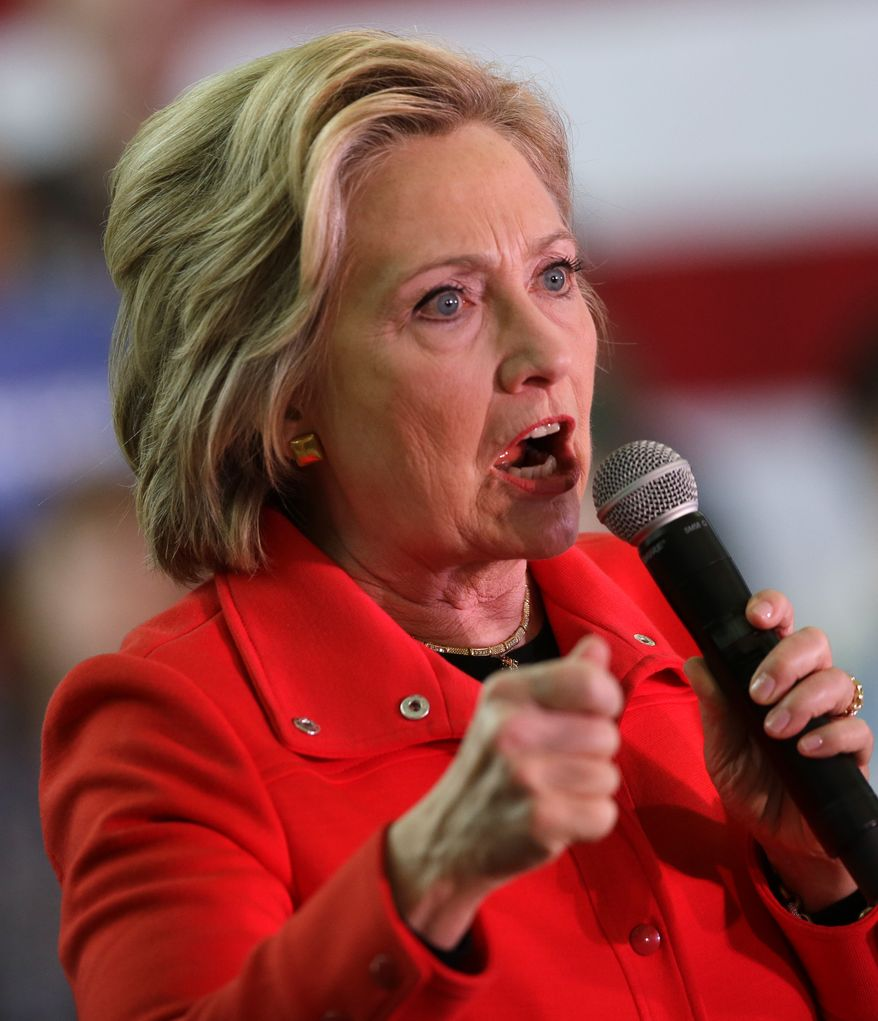 In attacking Republicans as liars during a rally in Nevada, Hillary Clinton broke into an impromptu series of barks Monday, imitating a truth-monitor dog. (Associated Press)