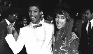 """Actor Taimak and Vanity (right) arrive at the Century Plitt Theater in Century City for the premiere of their film """"The Last Dragon"""" on March 22, 1985. (Associated Press)"""