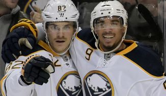 Buffalo Sabres Marcus Foligno (82) and Evander Kane (9) celebrate a goal by Foligno during the second period of an NHL hockey game against the Montreal Canadiens, Friday, Feb.12, 2016, in Buffalo, N.Y. Buffalo won 6-4. (AP Photo/Gary Wiepert)