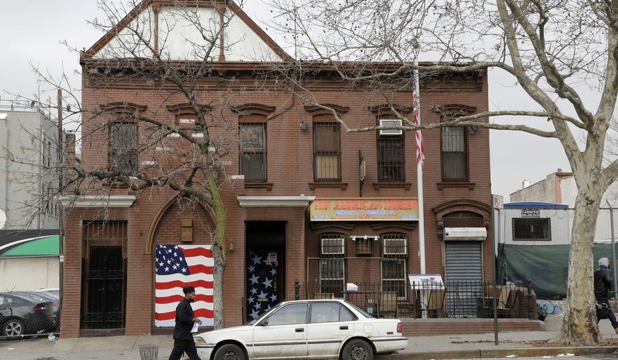 A man walks to his car in front of an American Legion Post, Tuesday, Feb. 9, 2016, in the Brooklyn borough of New York. A military author says it's time to find precisely where scores of Maryland soldiers are buried in the city so a monument can be erected on the spot to honor their sacrifice during the American Revolution, when they saved Gen. George Washington's army from defeat 240 years ago this summer. The soldiers are believed to be buried in the vicinity of the building. (AP Photo/Mark Lennihan)