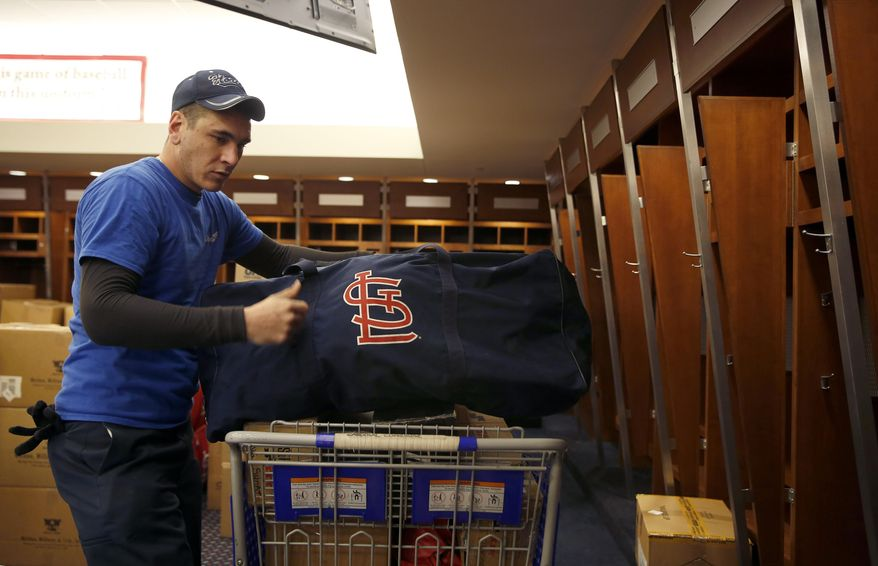 Dustin Heddy with United Van Lines packs up gear in the St. Louis Cardinals clubhouse to be sent to the baseball team's spring training facility Thursday, Feb. 11, 2016, in St. Louis. Cardinals pitchers and catchers are scheduled to report to camp on Feb. 17, 2016, in Jupiter, Fla. (AP Photo/Jeff Roberson)