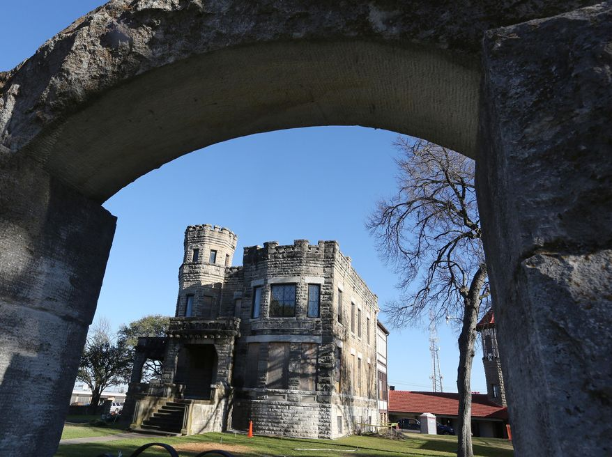 The Cottonland Castle, which has been a landmark and a vacant eyesore for the historic neighborhood, is under renovation by local contractors, Thursday, Feb. 11, 2016, in Waco, Texas. The project will  bring the 126-year-old castle into the 21st century while preserving its unique architecture. (Rod Aydelotte/Waco Tribune Herald, via AP)