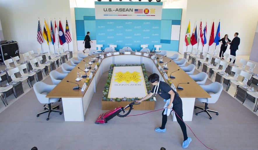 Maria Mendoza cleans and vacuums around the head table as last minute preparation are made at the Annenberg Retreat at Sunnylands in Rancho Mirage, Calif., site of today's meeting of ASEAN, the 10-nation Association of Southeast Asian Nations,  Monday, Feb. 15, 2016. President Barack Obama is hosting the ASEAN leaders, it is the first meeting of its kind on U.S. soil, as he looks to deepen ties with the region's fast-growing economies. (AP Photo/Pablo Martinez Monsivais)