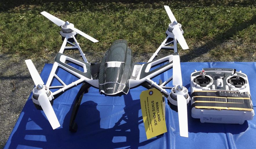 FILE - This Aug. 24, 2015, file photo shows a Yuneec Typhoon drone and controller in Jessup, Md. Maryland State Police and prison officials say two men planned to use the drone to smuggle drugs, tobacco and pornography videos into the maximum-security Western Correctional Institution near Cumberland, Md. Illinois has yet to see a case where drones have been used to illegally smuggle items into correctional facilities, according to state officials, but lawmakers are proposing legislation to penalize the activity after seeing what's happened in other states. (AP Photo/David Dishneau, File)