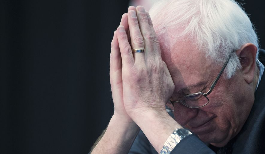 Democratic presidential candidate, Sen. Bernie Sanders, I-Vt. bows his head during a prayer at a breakfast with faith leaders at Allen University, Tuesday, Feb. 16, 2016, in Columbia, S.C. (AP Photo/Evan Vucci)