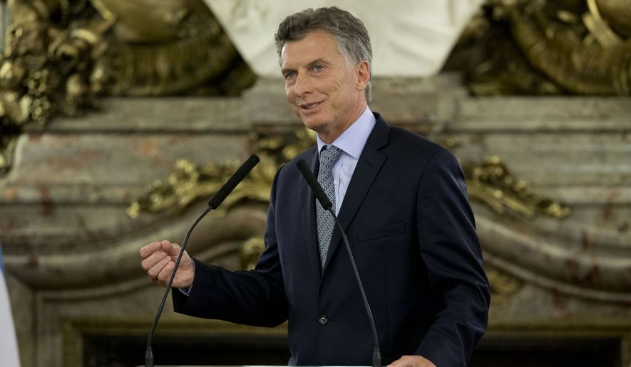 Argentina's President Mauricio Macri attends a press conference with Italy's Premier Matteo Renzi at the government in Buenos Aires, Argentina, Tuesday, Feb. 16, 2016. Renzi is on a two day official visit to Argentina. (AP Photo/Natacha Pisarenko)
